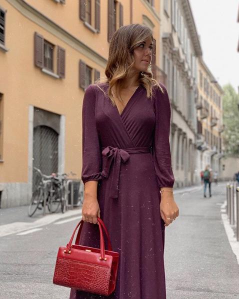 Lucrezia Candelori in abito Paperlace e borsa Amato Daniele